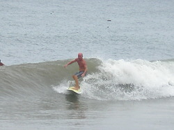 Small but clean right hander, Urbiztondo Beach photo