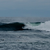 Surfing outer reef at Slip Point, WA