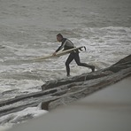 Jumping into the surf from Surfside Jetties-2-21-2015