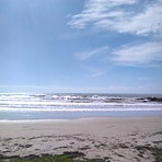 woolgoolga main beach with a bit of swell