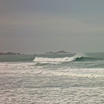 Big swell, Corbiere in background, St Ouen's Bay - Secrets