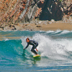 Surfing in Playa de Cueva, Asturias, Spain