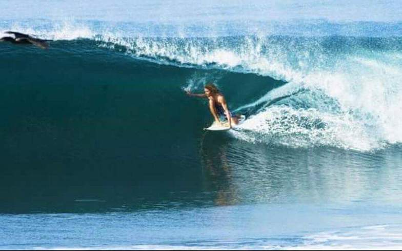 Abel estopin gliding under what inspired him before he surfed (pelicans) in paradise, Cuyutlan