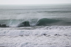 Going Deep, Wainui Beach - Stockroute photo