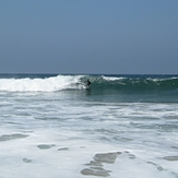 Surfer in wide view, Gillis