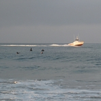 Lifeguard boat and surfers, Gillis