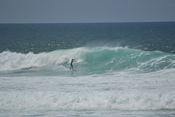Left local surfer, Itauna photo