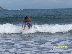 Emman Surfs the waves on Badoc Beach, Badoc Island Lefts photo