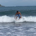 Emman Surfs the waves on Badoc Beach, Badoc Island Lefts