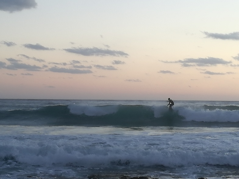 Evening surf at corner of the beach, Portixeddu