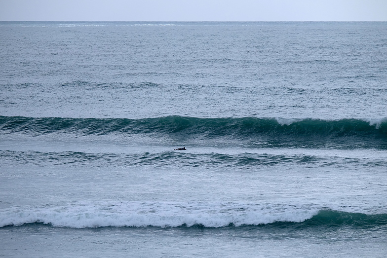 Rob L paddling out, Wharariki Beach