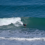 Michelle surfs a west coast shorey, Anatori River