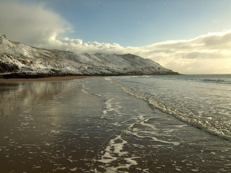 Snowy beach at Caswell Bay