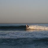 surfer at break near lifeguard tower 45, Gillis