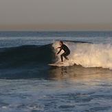 surfer at break near lifeguard tower 45 (cropped), Gillis