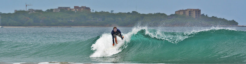 Patrick Mihalic catching a good wave in Playa Grande