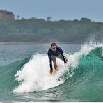 Patrick Mihalic catching a good wave in Playa Grande