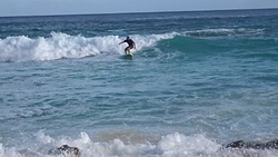 Surfing my foamie at Warwick Long Bay, Bouncer Beach photo