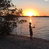 My son fishing at sunset