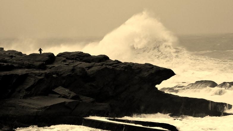 man on rock big swell 2, St Finan's Bay