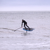 Surfing a SUP with a foil at Ruby Bay
