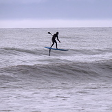 SUP surfing with a foil at Ruby Bay