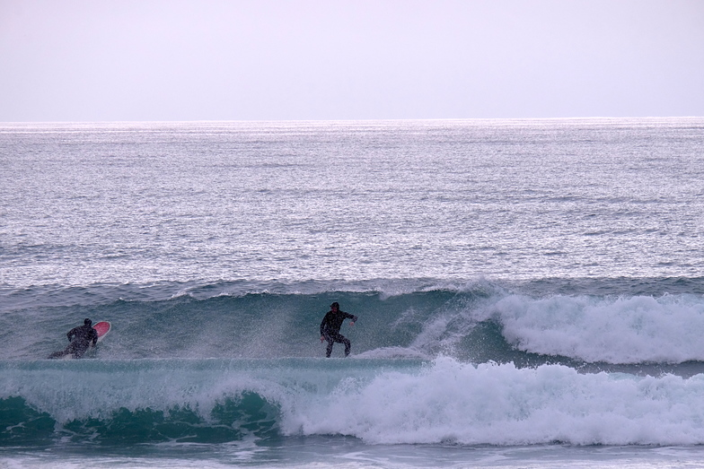 Rob Lewis and Rob Davies enjoy small clean waves at Schnappers, Schnappers Point