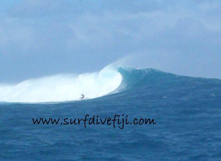Big wave at Cloudbreak Surfing Fiji