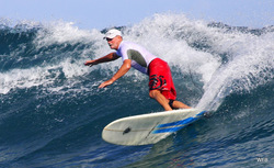 Bill cranking back to the reef at Nago Lefts Kavieng PNG photo