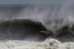 Tube ride - Hurricane Irene swell, St Augustine Beach Pier photo