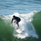 Surfing at Manhattan Beach Pier