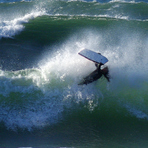 Boogie boarder does an El Rollo, Pacific City/Cape Kiwanda