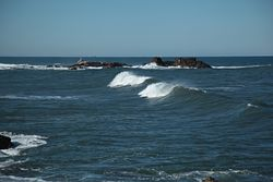 Waves in rocky bay, Praia do Aterro photo