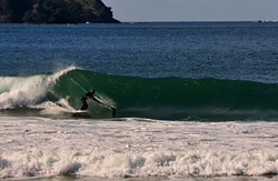 Al from Russell cranking off a sweet left-hand peak, Matauri Bay photo