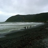 Surfers at Hongoeka Bay, The Pa