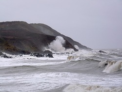 Storm surf at Langland Bay photo