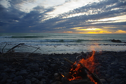 sunset and fire, Banks Peninsula - Magnet Bay photo