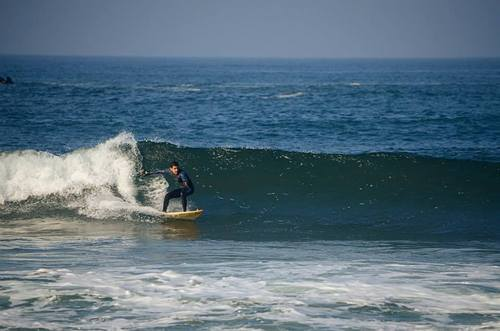 Surfing at the pier, Rosarito
