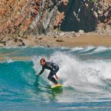 Surfing in Playa de Cueva, Asturias, Spain