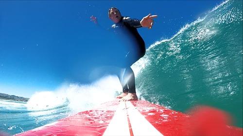 Summertime at St Kilda Phil on the red QB, Dunedin - St Kilda Beach