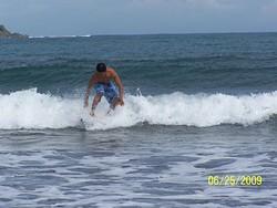 Emman Surfs the waves on Badoc Beach, Badoc Island Lefts photo