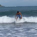 Emman Surfs the waves on Badoc Beach, Badoc Island Lefts