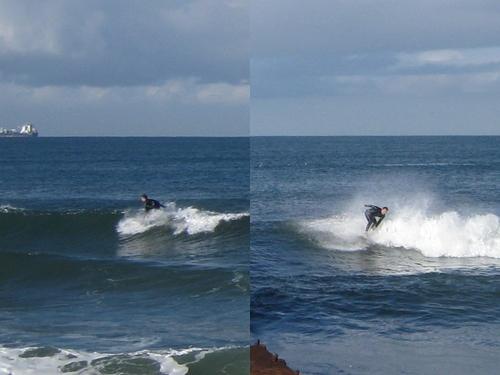 Surfers on each side of groyne (closeup), Gillis