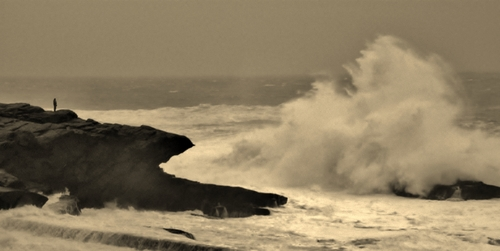 man on rock big swell, St Finan's Bay