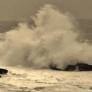 man on rock big swell, St Finan's Bay