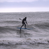 Stand up Paddle Board surfing with a foil at Ruby Bay