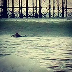 Paddling for a 3ft clean slab, Brighton