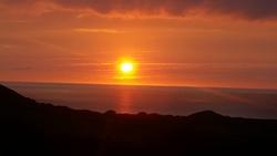 Sun setting, Putsborough photo