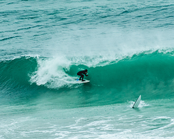 Surfer preparing for a sick barrel at Witsands! photo