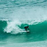 Surfer preparing for a sick barrel at Witsands!